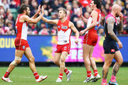 Josh Kennedy celebrates a goal with Kieren Jack (C) and Tom McCartin of the Swans (R) during the round 21 AFL match between the Melbourne Demons and the Sydney Swans at Melbourne Cricket Ground on August 12, 2018 in Melbourne, Australia.