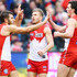 Josh Kennedy Kieren Jack Photos - Josh Kennedy celebrates a goal with Kieren Jack (C) and Tom McCartin of the Swans (R) during the round 21 AFL match between the Melbourne Demons and the Sydney Swans at Melbourne Cricket Ground on August 12, 2018 in Melbourne, Australia. - AFL Rd 21 - Melbourne vs. Sydney