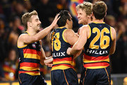 Jordan Gallucci ,Rory Sloane and Richard Douglas of the Adelaide Crows get around Eddie Betts after he kicked the last goal during the round 22 AFL match between the Adelaide Crows and North Melbourne Kangaroos at Adelaide Oval on August 19, 2018 in Adelaide, Australia.