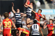 Jack Henry of the Cats leaps for a mark during the round 23 AFL match between the Geelong Cats and the Gold Coast Suns at GMHBA Stadium on August 25, 2018 in Geelong, Australia.