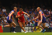 Daniel Harris of the Suns breaks out of the middle of the ground during the round three AFL match between the Western Bulldogs and the Gold Coast Suns at Etihad Stadium on April 9, 2011 in Melbourne, Australia.