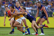 Dom Sheed of the Eagles looks to break from a tackle by Darcy Tucker of the Dockers = during the Round 6 AFL match between the Fremantle Dockers and West Coast Eagles at Optus Stadium on April 29, 2018 in Perth, Australia.