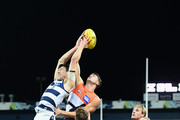 Jack Henry of the Cats marks infront of Jonathon Patton of the Giants  during the round seven AFL match between the Geelong Cats and the Greater Western Sydney Giants at GMHBA Stadium on May 4, 2018 in Geelong, Australia.