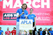 Josh Pence (L) and Maia Mitchell speak on stage during AIDS Walk Los Angeles 2019 on October 20, 2019 in Los Angeles, California.