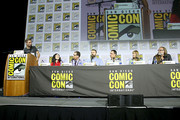 Chris Hardwick, Angela Kang, Scott M. Gimple, Robert Kirkman, Dave Alpert, Gale Anne Hurd and Greg Nicotero attend the Fear The Walking Dead Panel at Comic Con 2019 on July 19, 2019 in San Diego, California.