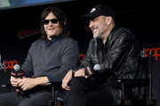 Norman Reedus and Jeffrey Dean Morgan speak onstage during a panel for AMC's The Walking Dead Universe including AMC's flagship series and the untitled new third series within The Walking Dead franchise at Hulu Theater at Madison Square Garden on October 05, 2019 in New York City.