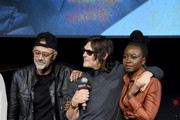 (L-R) Jeffrey Dean Morgan, Norman Reedus, and Danai Gurira speak onstage during a panel for AMC's The Walking Dead Universe including AMC's flagship series and the untitled new third series within The Walking Dead franchise at Hulu Theater at Madison Square Garden on October 05, 2019 in New York City.