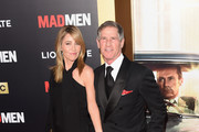 """Laurie Demarest and Lions Gate Entertainment CEO Jon Feltheimer attend the AMC celebration of the final 7 episodes of """"Mad Men"""" with the Black & Red Ball at the Dorothy Chandler Pavilion on March 25, 2015 in Los Angeles, California."""