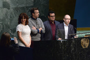 """(L-R) Maya Rudolph, Jason Sudeikis, Josh Gad and John Cohen speak on stage during the United Nations Ceremony, Presentation and Photo Call naming Red, from the """"ANGRY BIRDS"""" movie, Honorary Ambassador for the International Day of Happiness, to be observed around the world on March 20th, at United Nations on March 18, 2016 in New York City."""