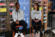 Gael Monfils (L) and Julia Gorges speak during the ASICS Tennis 5th Avenue Flagship Event on August 23, 2019 in New York City.