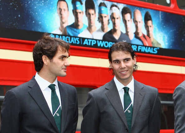 (L-R) Roger Federer of Switzerland and Rafael Nadal of Spain chat in front of a London Bus during the Barclays ATP World Tour Finals - Media Day at the County Hall Marriot Hotel on November 20, 2009 in London, England.