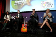 (L-R) GRAMMY Award Winning Artist Estelle, Singer/Songwriter Greg Holden, CEO Global Poverty Project Hugh Evans and Founder & President of MAC Presents Marcie Allen speak onstage at the Play It Forward panel presented by Mac Presents during Advertising Week 2015 AWXII at the Hard Rock Cafe New York on September 28, 2015 in New York City.