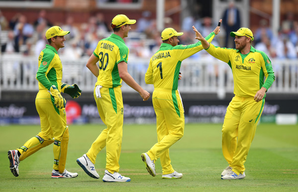 England v Australia - ICC Cricket World Cup 2019 [sports,limited overs cricket,cricketer,team sport,ball game,cricket,one day international,first-class cricket,yellow,bat-and-ball games,aaron finch,team mates,r,usman khawaja of australia,wicket,group stage,australia,england,2r,australia - icc cricket world cup]