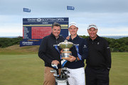Justin Rose of England (centre) celebrates on the 18th green with his friend and Management team member Paul McDonnell (left) and caddie Mark Fulcher (right) after winning the Aberdeen Asset Management Scottish Open at Royal Aberdeen on July 13, 2014 in Aberdeen, Scotland.