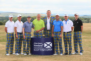 (L-R) Marc Warren of Scotland, Kevin Chappell of the USA, Russell Knox of Scotland, Gavin Hastings and Doddie Weir (former Scotland rugby players), David Howell of England, Stephen Gallacher of Scotland and Martin Laird of Scotland  pose for a photograph on Tartan Wednesday during the Pro Am event prior to the start of the Aberdeen Standard Investments Scottish Open at Gullane Golf Course on July 11, 2018 in Gullane, Scotland.