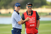 Justin Rose of England and caddie Mark Fulcher talk during the pro-am prior to the Abu Dhabi HSBC Golf Championship at Abu Dhabi Golf Club on January 17, 2018 in Abu Dhabi, United Arab Emirates.