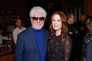 """Filmmaker Pedro Almodovar and actress Julianne Moore attend The Academy of Motion Picture Arts and Sciences """"2019 New Members Party"""" at the Top of the Standard in New York on October 1, 2019 in New York City."""
