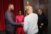 (L-R) Actors Winston Duke and Lupita Nyong'o, AMPAS New York director of programs and membership Patrick Harrison and director Jordan Peele attend The Academy of Motion Picture Arts and Sciences official screening of Us at the MoMA Celeste Bartos Theater on March 18, 2019 in New York City.