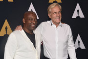 "John Singleton and Randal Kleiser attend the Academy Presents ""Grease"" (1978) 40th Anniversary at the Samuel Goldwyn Theater on August 15, 2018 in Beverly Hills, California."