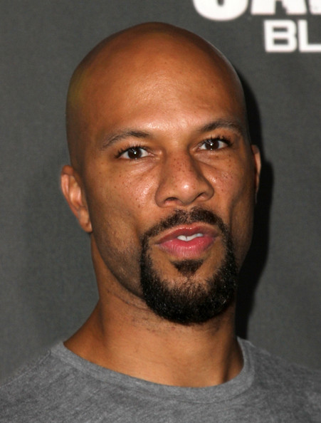 common rapper style. Rapper Common arrives at