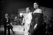 """Image has been converted to black and white.) Ruth Negga and Liv Tyler walk the red carpet ahead of the """"Ad Astra"""" screening during the 76th Venice Film Festival at Sala Grande on August 29, 2019 in Venice, Italy."""