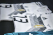 Image has been digitally enhanced.) Customized jerseys of  (L-R) Timo Werner, Thomas Mueller and Mats Hummels for the world cup group stage matches are seen during a visit of the Adidas production site on June 13, 2018 in Scheinfeld, Germany.