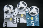 Image has been digitally enhanced.) Customized jerseys of  (L-R) Timo Werner, Thomas Mueller and Mats Hummels and customized official match balls for the world cup group stage matches are seen during a visit of the Adidas production site on June 13, 2018 in Scheinfeld, Germany.