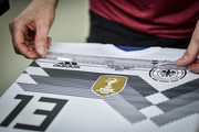 Image has been digitally enhanced.) A worker inspects a customized home jersey of Thomas Mueller for the world cup match of Germany against Sweden during a visit of the Adidas production site on June 13, 2018 in Scheinfeld, Germany.