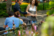 Andy Ostroy, widower of Adrienne Shelly and executive director of the Adrienne Shelly Foundation speaks with actress Mary Louise Parker at the Adrienne Shelly Memorial Garden dedication ceremony at Abingdon Square Park on August 3, 2009 in New York City.
