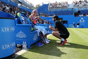 Sabine Lisicki of Germany speaks to her coach Christopher Kas in her quarter final match over Daniela Hantuchova of Slovakia on day five of the Aegon Classic at Edgbaston Priory Club on June 19, 2015 in Birmingham, England.