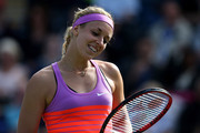 Sabine Lisicki of Germany looks at her racket during her semi final match against Angelique Kerber of Germany on day six of the Aegon Classic at Edgbaston Priory Club on June 20, 2015 in Birmingham, England.