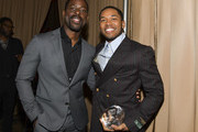 (L-R) Sterling K. Brown and Kelvin Harrison Jr. pose for portrait at The African American Film Critics Association's 11th Annual AAFCA Awards at Taglyan Cultural Complex on January 22, 2020 in Hollywood, California.
