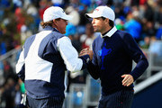 Phil Mickelson (L) of the United States shakes hands with Keegan Bradley on the 7th hole during the Afternoon Foursomes of the 2014 Ryder Cup on the PGA Centenary course at the Gleneagles Hotel on September 26, 2014 in Auchterarder, Scotland.