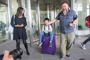 Chinese dissident artist Ai Weiwei leaves Munich Airport with is his wife Lu Qing and his son Ai Lao, aged 6, on July 30, 2015 in Munich, Germany. This is his first trip abroad since Chinese authorities put him under house arrest in 2011 and confiscated his passport without charging him with any crime. They recently returned his passport, enabling Ai Weiwei to travel to see his son, who lives in Berlin. His UK visa application, however, has been rejected because the artist failed to mention any convictions.