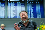 Chinese dissident artist Ai Weiwei upon his arrival at Munich Airport on July 30, 2015 in Munich, Germany. This is his first trip abroad since Chinese authorities put him under house arrest in 2011 and confiscated his passport without charging him with any crime. They recently returned his passport, enabling Ai Weiwei to travel to see his son, who lives in Berlin. His 6-month UK visa application, however, has been rejected because the artist failed to mention any convictions, although he has been granted a 20-day visa to attend the opening of his show in London in September.