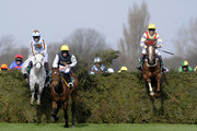 Silver Adonis and Mr Tom Weston (grey horse) take the chair on their way to victory in The John Smith's Fox Hunters' Steeple Chase at Aintree racecourse on April 08, 2010 in Liverpool, England