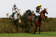 Baby Run ridden by S.Twiston-Davies clears The Chair just ahead of the eventual winner, Silver Adonis ridden by Tom Weston, during The John Smith's Fox Hunters' Steeple Chase at Aintree Racecourse on April 8, 2010 in Liverpool, England.