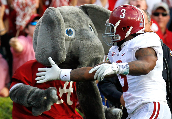 Trent Richardson #3 of the Alabama Crimson Tide celebrates his touchdown against the Auburn Tigers with mascot Big Al at Jordan-Hare Stadium on November 26, 2011 in Auburn, Alabama.