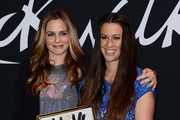 Alanis Morissette and Alicia Silverstone Photos Photo