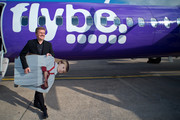 """Aled Jones departs a FLYBE flight after launching his new Christmas album """"One Voice At Christmas"""" where he performed Walking In The Air and Christmas carols for passengers at 18,000ft on a FLYBE service between London and Cardiff on October 13, 2016 in Cardiff, United Kingdom."""