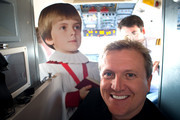 """Aled Jones poses for photographs after launching his new Christmas album """"One Voice At Christmas"""" where he performed Walking In The Air and Christmas carols for passengers at 18,000ft on a FLYBE service between London and Cardiff on October 13, 2016 in Cardiff, United Kingdom."""