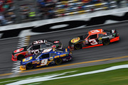 Chase Elliott, driver of the #9 NAPA Auto Parts Chevrolet, races Austin Dillon, driver of the #33 Rheem Chevrolet, ahead of Ty Dillon, driver of the #3 Bass Pro Shops Chevrolet, during the NASCAR XFINITY Series Alert Today Florida 300 at Daytona International Speedway on February 21, 2015 in Daytona Beach, Florida.