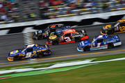 Chase Elliott, driver of the #9 NAPA Auto Parts Chevrolet, leads a pack of cars during the NASCAR XFINITY Series Alert Today Florida 300 at Daytona International Speedway on February 21, 2015 in Daytona Beach, Florida.