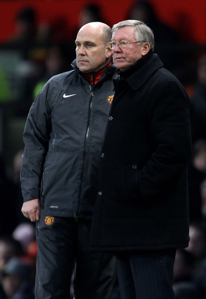 Alex Ferguson Manchester United Manager Sir Alex Ferguson watches the action with Assistant Mike Phelan (L) during the Barclays Premier League match between Manchester United and Sunderland at Old Trafford on December 26, 2010 in Manchester, England.