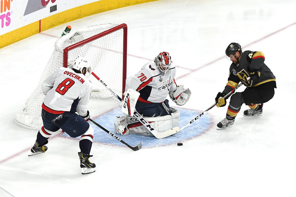 2018 NHL Stanley Cup Final - Game Two [game two,player,college ice hockey,ice hockey,ice hockey position,sports,sports gear,hockey,hockey protective equipment,ice hockey equipment,team sport,alex ovechkin 8,braden holtby,ryan carpenter,shot,nhl,washington capitals,vegas golden knights,stanley cup final,game]