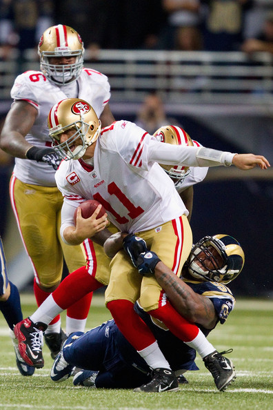 Alex Smith sacked by the Rams' Fred Robbins in a 2010 matchup. Photo by Dilip Vishwanat/Getty Images North America