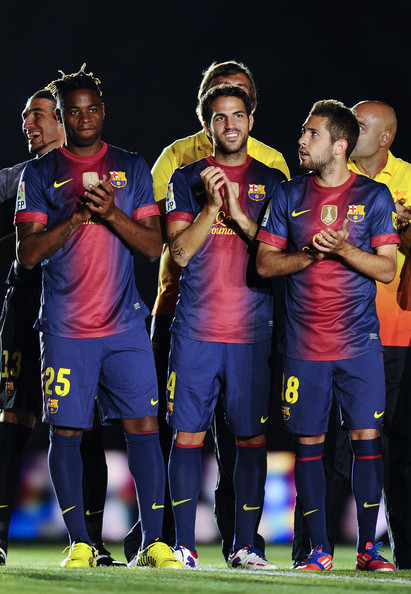 Alex Song Newly signed FC Barcelona player Alex Song (L), Cesc Fabregas (C) and Jordi Alba of FC Barcelona look on prior to the Joan Gamper Trophy friendly match between FC Barcelona and Sampdoria at Camp Nou on August 20, 2012 in Barcelona, Spain.