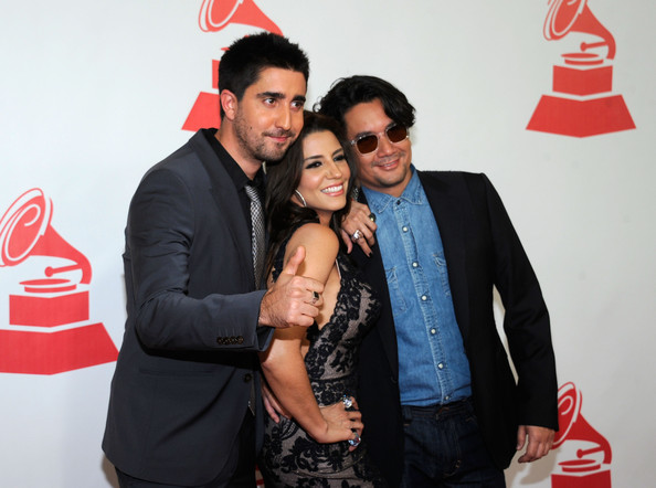 2011 Latin Recording Academy Person Of The Year Honoring Shakira - Arrivals [latin recording academy person of the year,red,event,fun,photography,coca-cola,suit,drink,cola,arrivals,alex ubago,shakira,alex jorge y lena,jorge villamizar,lena burke,l-r,band,latin recording academy]
