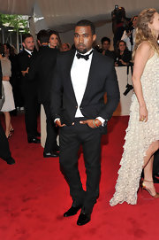 Kanye West showed off his dapper side in a custom made black tuxedo. Leave it to Kanye to request a sharp suit from a womens wear designer.