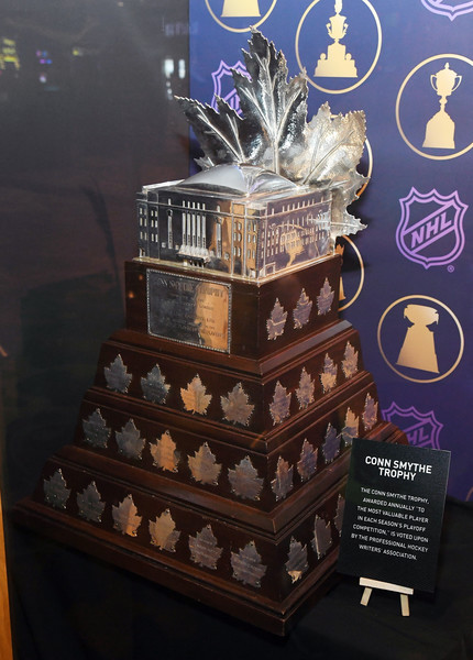 NHL Trophies Displayed At The Hard Rock Hotel & Casino Ahead Of The 2018 NHL Awards [dessert,chocolate,cake,wedding cake,player,trophies,conn smythe trophy,glass case,hard rock hotel casino ahead of the 2018 nhl awards,hard rock hotel casino,nhl,washington capitals,nhl awards,stanley cup playoffs]